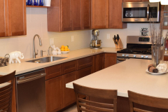 Residential Kitchen Counter and Island of Solid Surface with Undermount Stainless Steel Sink. DIY Created.