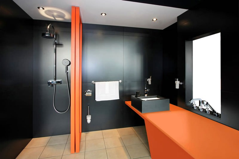 Residential Shower Wall, Sink Surround and Vanity Top with Integrated Solid Surface Tub. of LG HI-MACS Black and Florida Orange Solid Surface