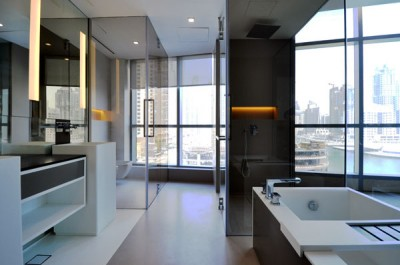 Hospitality Bathroom With Avonite Solid Surface Cabinets and Vanity Tops