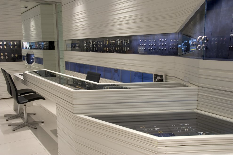 Retail Display Cases and Walls, Corian White Solid Suface