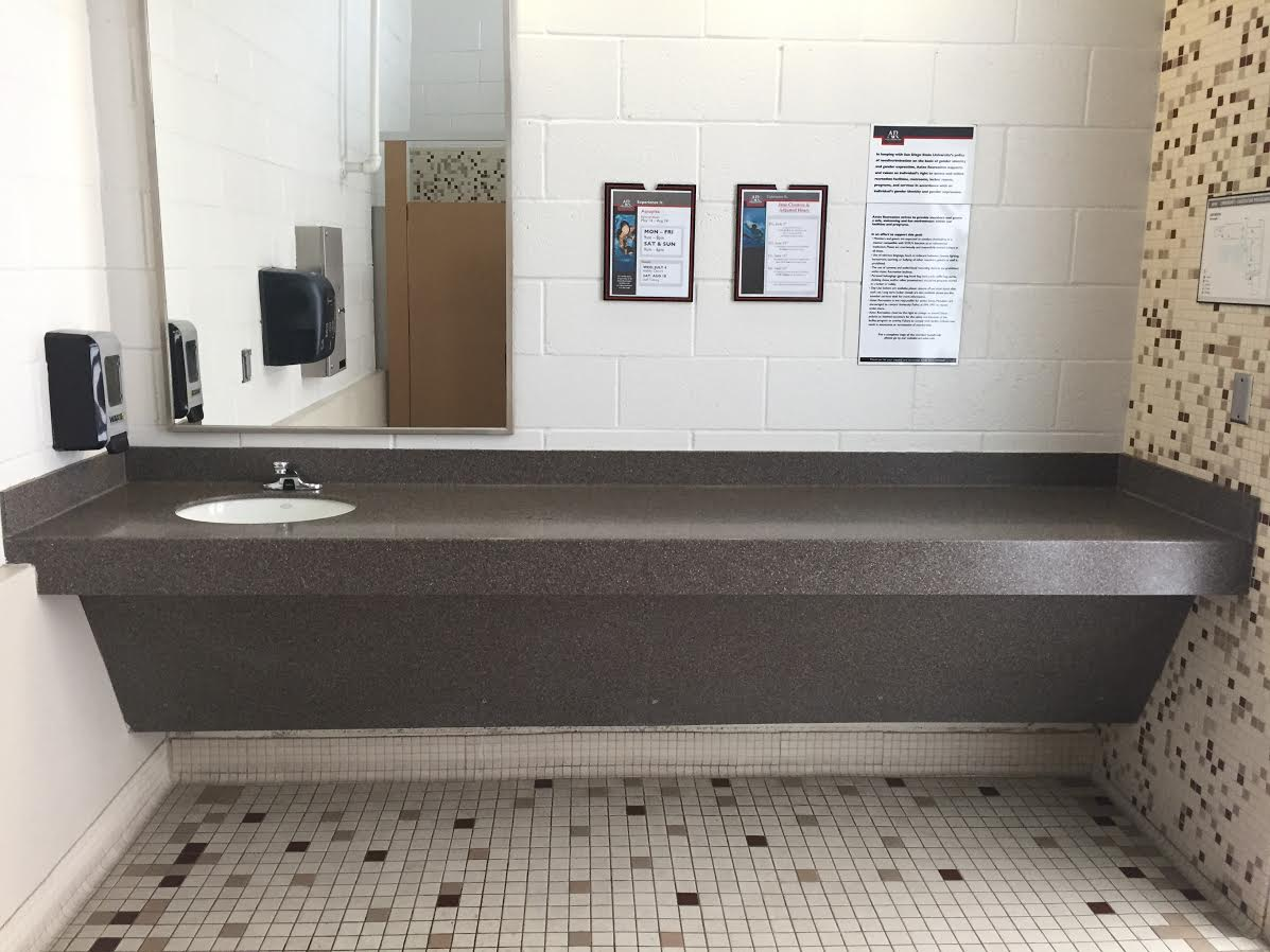 University of California San Diego Gym Restroom Countertop in Solid Surface with Undermount Porcelain Sink, Coved Backsplash, and  Front Apron 1