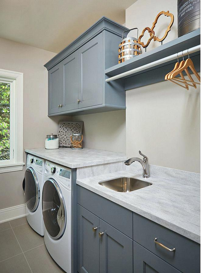 Laundry Room with Solid Surface Countertops and Stainless Sink