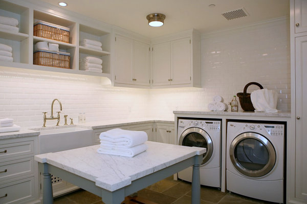 Laundry room with solid surface island and countertops.