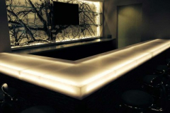 Backlit Bar Top, and Backlit Sculpted Back Wall of Avonite Studio Collection Solid Surface