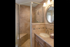 Mystera Solid Surface Shower Walls, Vanity Top and Sink in a Residential Bathroom