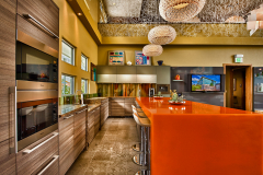 Avonite Studio Collection Amber Glass and New Cauldron Solid Surface Countertops in a Residential Kitchen